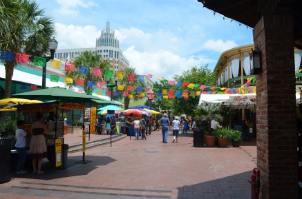 "Colored cut-outs hang on top of the square, making the ""fiesta"" atmosphere even more vibrant!"