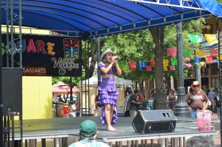 A very young Latina singer from San Antonio; she sang a mix of Selena and other big Latino artists.