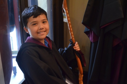 My brother tries out a Harry Potter robe and wand!
