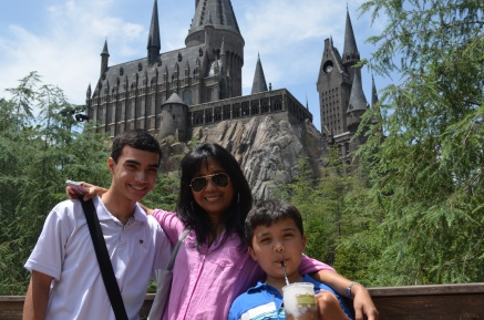 Me, my mom, and Jude in front of Hogwarts Castle