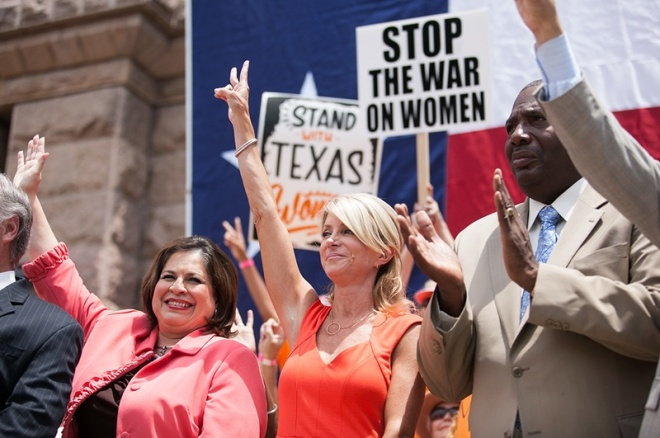 Sen. Leticia Van de Putte and Sen. Wendy Davis at the Stand with Texas Women Rally at the Capitol after the filibuster. (Photo by: Callie Richmond)